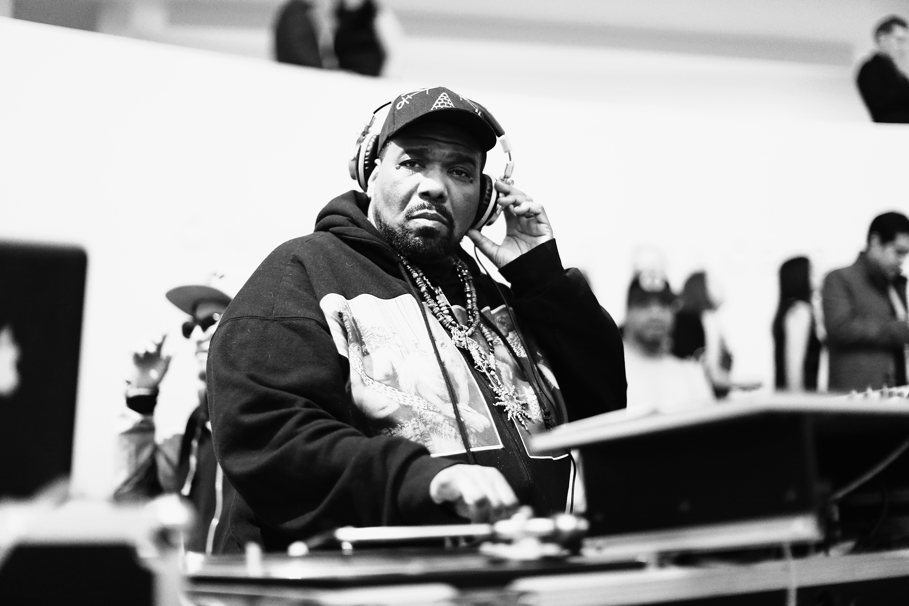 NEW YORK, NY - MARCH 19: (EDITORS NOTE: Image has been converted to black and white.) DJ Afrika Bambaataa performs during the 2015 Guggenheim Young Collectors party supported by David Yurman at Guggenheim Museum on March 19, 2015 in New York City. (Photo by Neilson Barnard/Getty Images for David Yurman)
